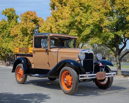 AUT 14 RK2019 01 © Kimball Stock 1930 Ford Model A Pickup Brown 3/4 Front View On Pavement By Trees