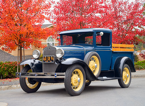 AUT 14 RK2026 01 © Kimball Stock 1931 Ford Model A Closed Cab 82-B Pickup Blue 3/4 Front View By Autumn Trees