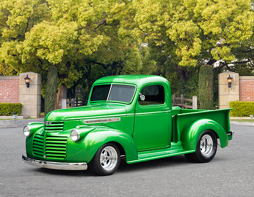 AUT 14 RK2027 01 © Kimball Stock 1942 GMC CC-Series Pickup Green 3/4 Front View On Pavement By Trees