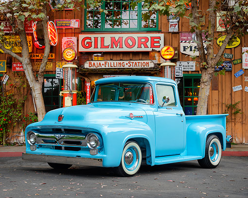 AUT 14 RK2029 01 © Kimball Stock 1955 Ford F-100 Pickup Blue 3/4 Front View By Gas Station