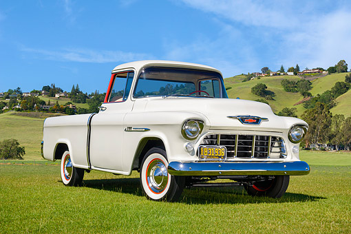 AUT 14 RK2039 01 © Kimball Stock 1955 Chevrolet Task Force Cameo 3100 Pickup White 3/4 Front View On Grass By Hills