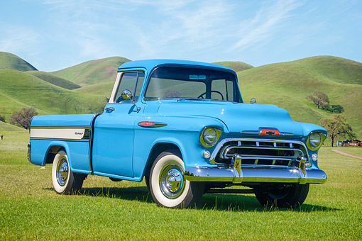 AUT 14 RK2040 01 © Kimball Stock 1957 Chevrolet Task Force Cameo Carrier 3124 Pickup Blue 3/4 Front View On Grass By Hills