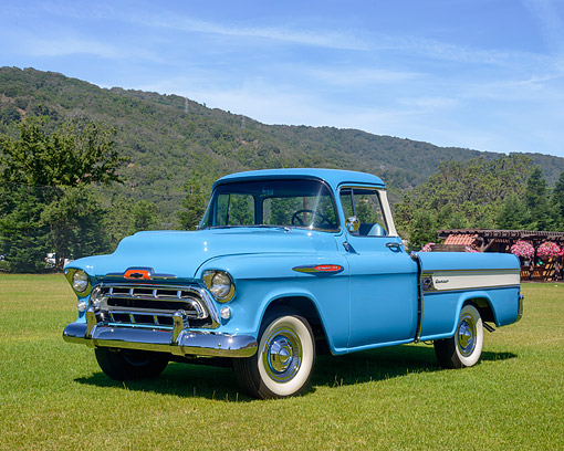 AUT 14 RK2041 01 © Kimball Stock 1957 Chevrolet Task Force Cameo Carrier 3124 Pickup Blue 3/4 Front View On Grass By Hills