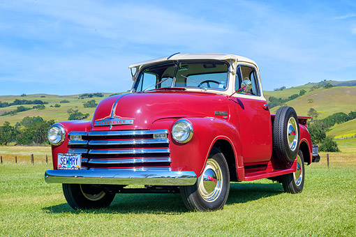 AUT 14 RK2044 01 © Kimball Stock 1951 Chevrolet Advance Design 3100 Pickup Red And White 3/4 Front View On Green Pasture