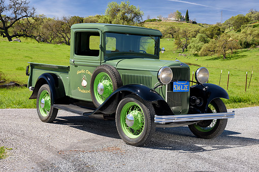 AUT 14 RK2062 01 © Kimball Stock 1932 Ford Model B Pickup Pea Green 3/4 Front View By Grassy Hills