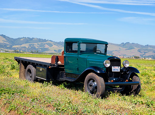 AUT 14 RK2065 01 © Kimball Stock 1931 Ford Model AA Truck  Green 3/4 Front View On Grass By Hills