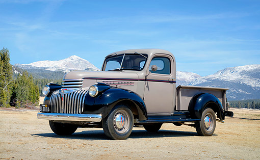 AUT 14 RK2071 01 © Kimball Stock 1946 Chevrolet AK Series Gray And Black 3/4 Front By Forest And Mountains