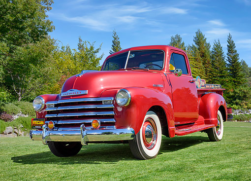AUT 14 RK2073 01 © Kimball Stock 1952 Chevrolet Advance-Design 3100 Pickup Red 3/4 Front View On Grass By Trees