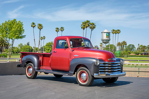 AUT 14 RK2074 01 © Kimball Stock 1953 Chevrolet Advance Design 3600 Pickup Red And Gray 3/4 Front View By Palm Trees