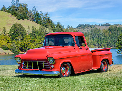 AUT 14 RK2075 01 © Kimball Stock 1955 Chevrolet 1500 Advance Design Pick Up Red 3/4 Front View By Lake And Grass