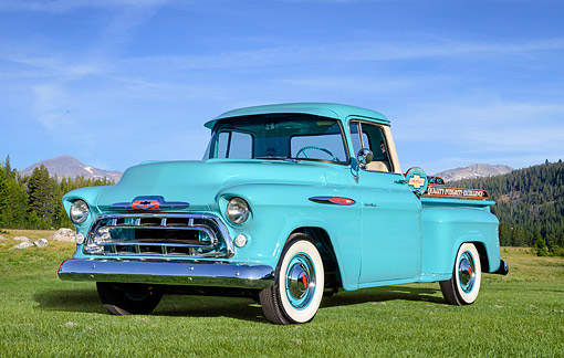 AUT 14 RK2076 01 © Kimball Stock 1957 Chevrolet Task Force 3100 Hydramatic Pickup Turquoise 3/4 Front View By Trees And Mountains