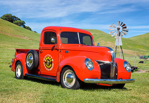 AUT 14 RK2081 01 © Kimball Stock 1941 Ford Pickup Red 3/4 Front On Grass By Windmill