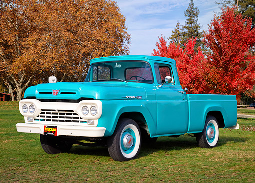 AUT 14 RK2082 01 © Kimball Stock 1960 Ford F100 Pickup Green 3/4 Front View On Grass By Autumn Trees