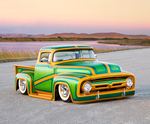 AUT 14 BK0029 01 © Kimball Stock 1956 Ford F-100 Pickup Truck Custom Green And Gold 3/4 Front View On Pavement By Hills And Lake
