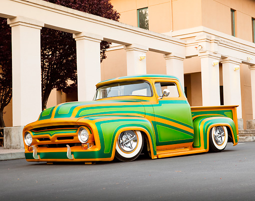 AUT 14 BK0031 01 © Kimball Stock 1956 Ford F-100 Pickup Truck Custom Green And Gold 3/4 Front View On Pavement By Columns And Building