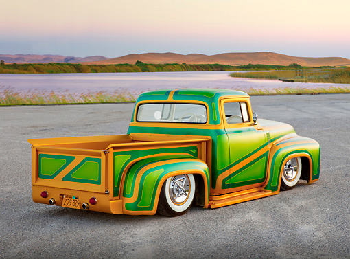 AUT 14 BK0032 01 © Kimball Stock 1956 Ford F-100 Pickup Truck Custom Green And Gold 3/4 Rear View On Pavement By Hills And Lake