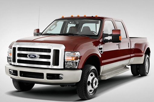 AUT 14 IZ0018 01 © Kimball Stock 2010 Ford F-350 Crew Cab Pickup Truck Maroon 3/4 Front View Studio