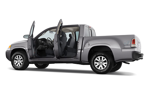 AUT 14 IZ0069 01 © Kimball Stock 2008 Mitsubishi Raider Double Cab LS Pickup Truck Gray Doors Open 3/4 Rear View Studio