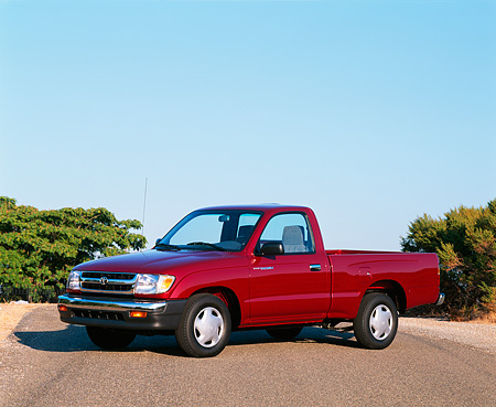 AUT 14 RK0001 04 © Kimball Stock 1997 Toyota Tacoma Truck Maroon 3/4 Side View On Pavement