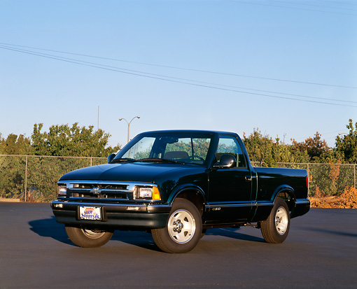 AUT 14 RK0017 03 © Kimball Stock 1997 Chevrolet S-10 Standard Cab Green 3/4 Front View On Pavement Trees Blue Sky