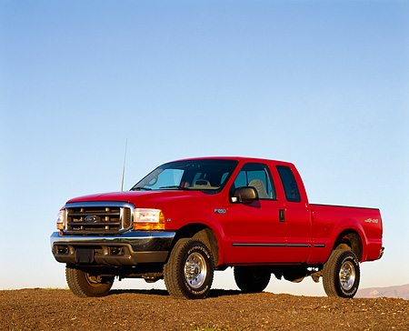 AUT 14 RK0043 04 © Kimball Stock 1999 Ford F250 XLT Super Duty 4x4 Triton V10 Red 3/4 Front View On Dirt Blue Sky