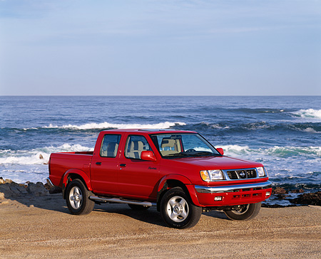 AUT 14 RK0067 07 © Kimball Stock 2000 Nissan Frontier Crew Cab SE Prototype Red Pick Up Truck 3/4 Side View On Beach