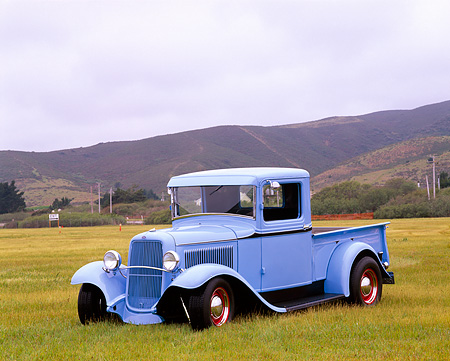 AUT 14 RK0096 01 © Kimball Stock 1933 Ford P.V. Truck Blue Side 3/4 View On Grass