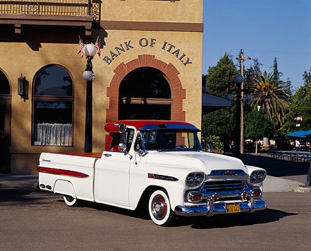 AUT 14 RK0109 02 © Kimball Stock 1959 Chevy Apache Fleetside Pick Up Truck White 3/4 Front View On Pavement By Building