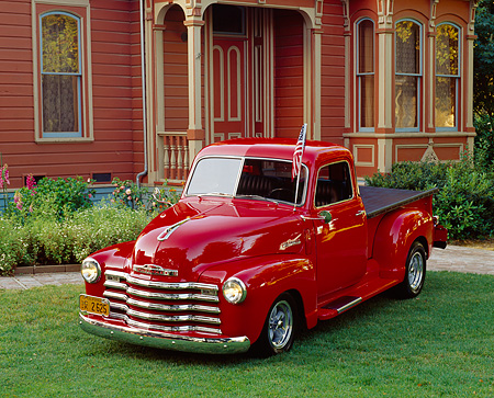 AUT 14 RK0114 03 © Kimball Stock 1948 Chevrolet Thriftmaster Truck Red 3/4 Front View On Grass By House