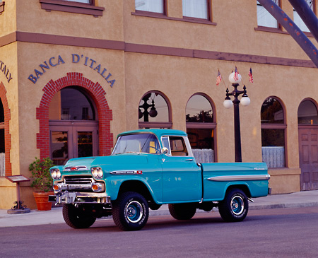 AUT 14 RK0116 02 © Kimball Stock 1959 Chevrolet Apache Pickup Truck Aqua 3/4 Side View On Pavement By Building