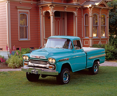 AUT 14 RK0117 03 © Kimball Stock 1959 Chevrolet Apache Pickup Truck Aqua 3/4 Front View On Grass By House