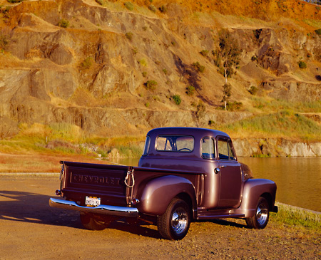 AUT 14 RK0132 01 © Kimball Stock 1954 Chevrolet 3100 1/2 Ton Truck Gray 3/4 Rear View On Dirt By Water