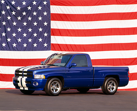 AUT 14 RK0229 01 © Kimball Stock Dodge Viper Ram VTS Concept Truck Blue 3/4 Side View American Flag Background