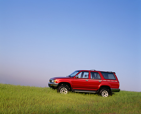 AUT 14 RK0239 03 © Kimball Stock 1992 Toyota 4Runner Burgundy 3/4 Front View On Grass