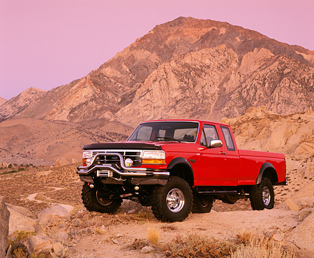 AUT 14 RK0276 02 © Kimball Stock 1995 Ford F250 4x4 Pickup Truck Red 3/4 Front View On Dirt Hill Filtered