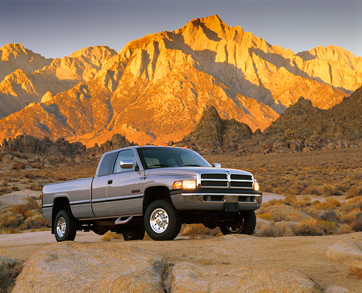 AUT 14 RK0279 04 © Kimball Stock 1997 Dodge Ram 2500 Diesel Pickup Truck Low 3/4 Front View On Rocks
