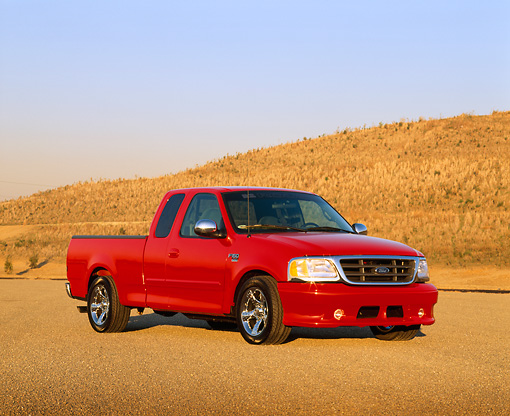 AUT 14 RK0329 03 © Kimball Stock 2000 Ford Roush F-150 XLT Truck Red 3/4 Front View On Pavement By Hills Blue Sky