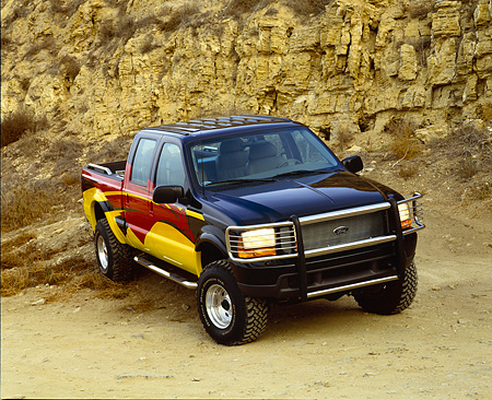 AUT 14 RK0336 18 © Kimball Stock 2000 Ford F350 4x4 Crew Cab Steel Horse Custom Pickup Truck 3/4 Front View On Dirt