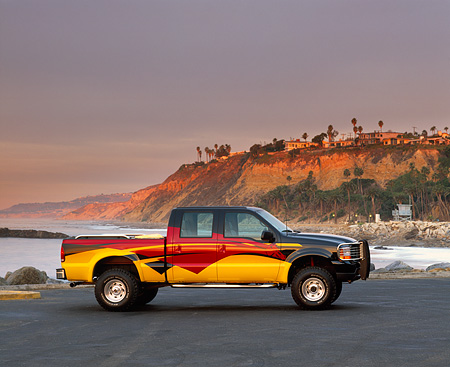 AUT 14 RK0340 05 © Kimball Stock 2000 Ford F350 4x4 Crew Cab Steel Horse Custom Pickup Truck Profile On Pavement On Coast