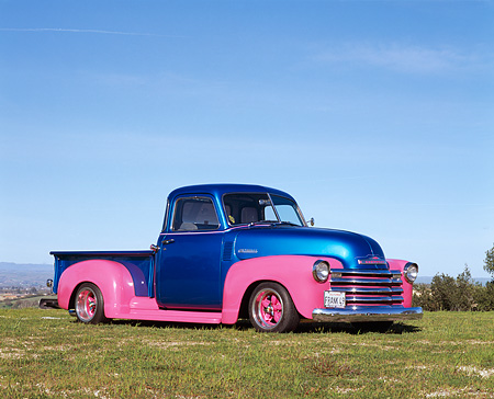 AUT 14 RK0380 03 © Kimball Stock 1949 Chevrolet Custom Pickup Truck Blue And Pink 3/4 Side View On Grass