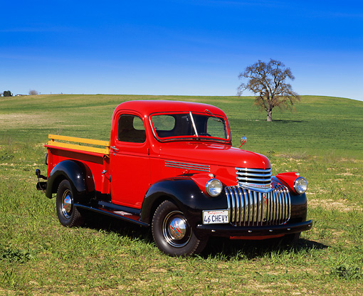 AUT 14 RK0383 01 © Kimball Stock 1946 Chevrolet Pickup Truck Red 3/4 Front View On Grass