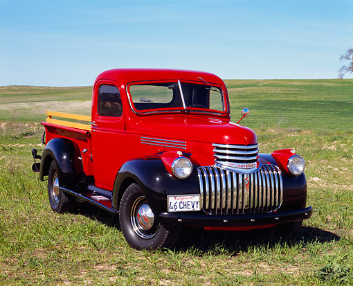 AUT 14 RK0383 03 © Kimball Stock 1946 Chevrolet Pickup Truck Red 3/4 Front View On Grass