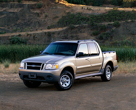 AUT 14 RK0413 02 © Kimball Stock 2001 Ford Explorer Sport Trac 4x4 Gold 3/4 Front View On Dirt