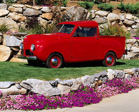 AUT 14 RK0437 01 © Kimball Stock 1948 Crosley Pickup Truck Red 3/4 Side View On Grass By Rocks