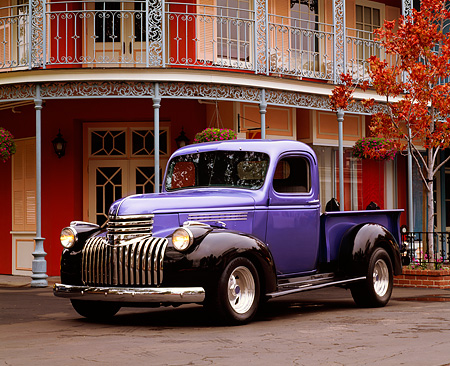 AUT 14 RK0453 01 © Kimball Stock 1941 Chevy 1/2 Ton Pick Up Truck Black And Purple 3/4 Front View On Pavement By Building
