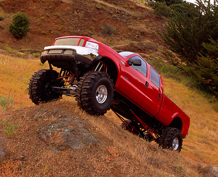 AUT 14 RK0513 08 © Kimball Stock 2000 Ford F-350 4x4 Crew Cab Pick Up Red Slanted 3/4 Side View On Dirt Hill