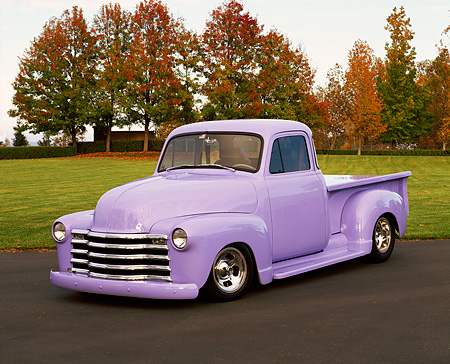 AUT 14 RK0654 03 © Kimball Stock 1950 Chevy Pickup Truck Periwinkle 3/4 Front View On Pavement By Grass Fall Trees