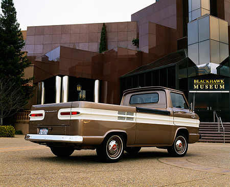 AUT 14 RK0661 01 © Kimball Stock 1964 Chevrolet Corvair 95 Rampside Tan And White 3/4 Rear View On Pavement By Building