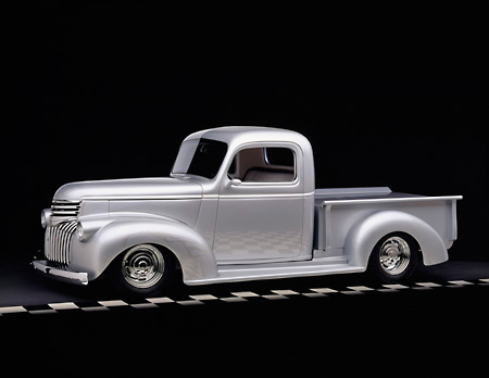 AUT 14 RK0663 01 © Kimball Stock 1946 Chevrolet Pickup Silver 3/4 Side View On Checkered Line Studio