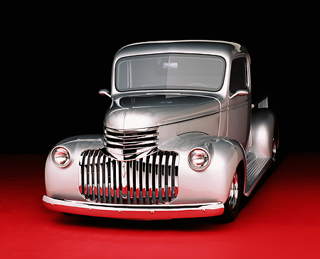 AUT 14 RK0672 02 © Kimball Stock 1946 Chevy Pick Up Truck Silver 3/4 Front View On Red Floor Studio